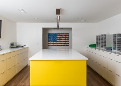 work room with yellow island